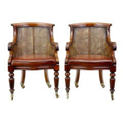 PAIR OF MAHOGANY BERGERE LIBRARY CHAIRS