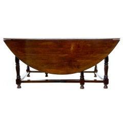 19TH CENTURY OAK ENGLISH GATELEG TABLE SEATS 12