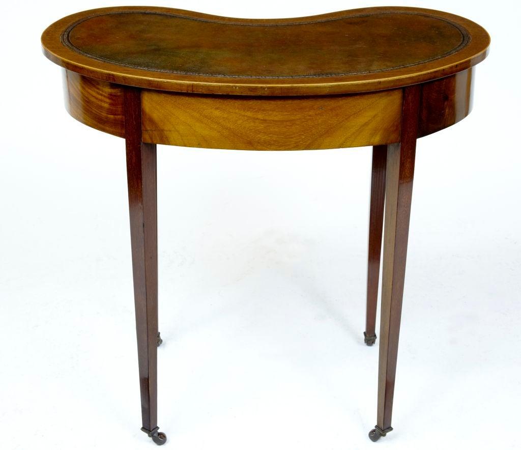 kidney shaped writing desk Product description design, including a unique kidney shaped desk made with hardwood solids.