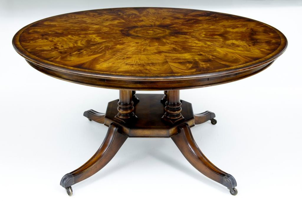 this large walnut jupe table with 5 leaves seats 10 is no longer