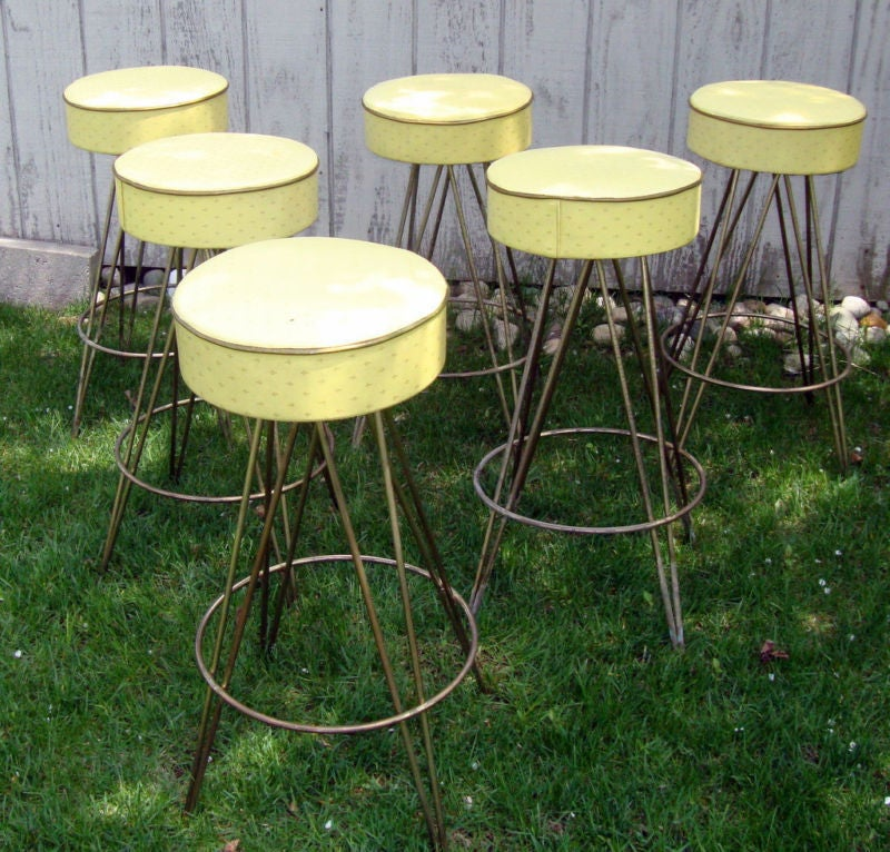 a great set of 6 barstools from probably the late 50's or early 60's. they are heavy and strong. they have swivel seats. the upholstery is original and can be switched out to match your place. can also be powdercoated in any color. priced