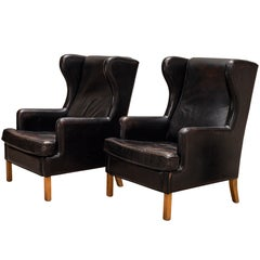 Pair of Black Leather Wingbacks