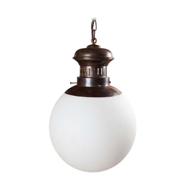 brass and glass globe pendant at 1stdibs