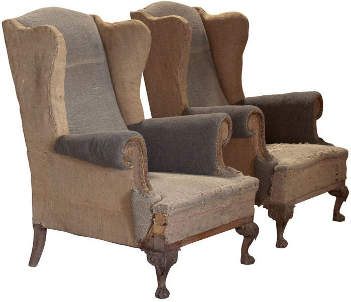 Pair of primitive tall wingback lounge chairs