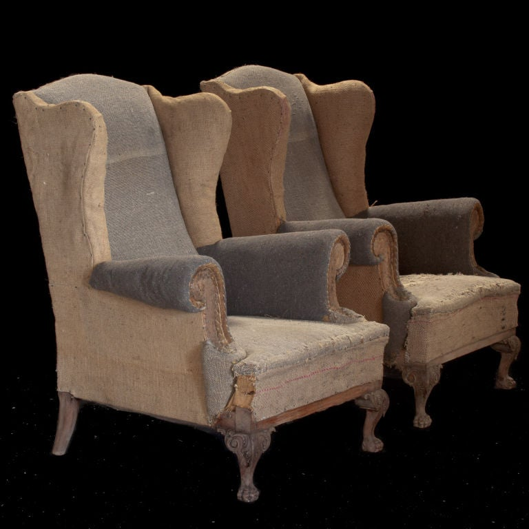 Pair of primitive tall wingback lounge chairs with unusual tattered grey/beige burlap fabric