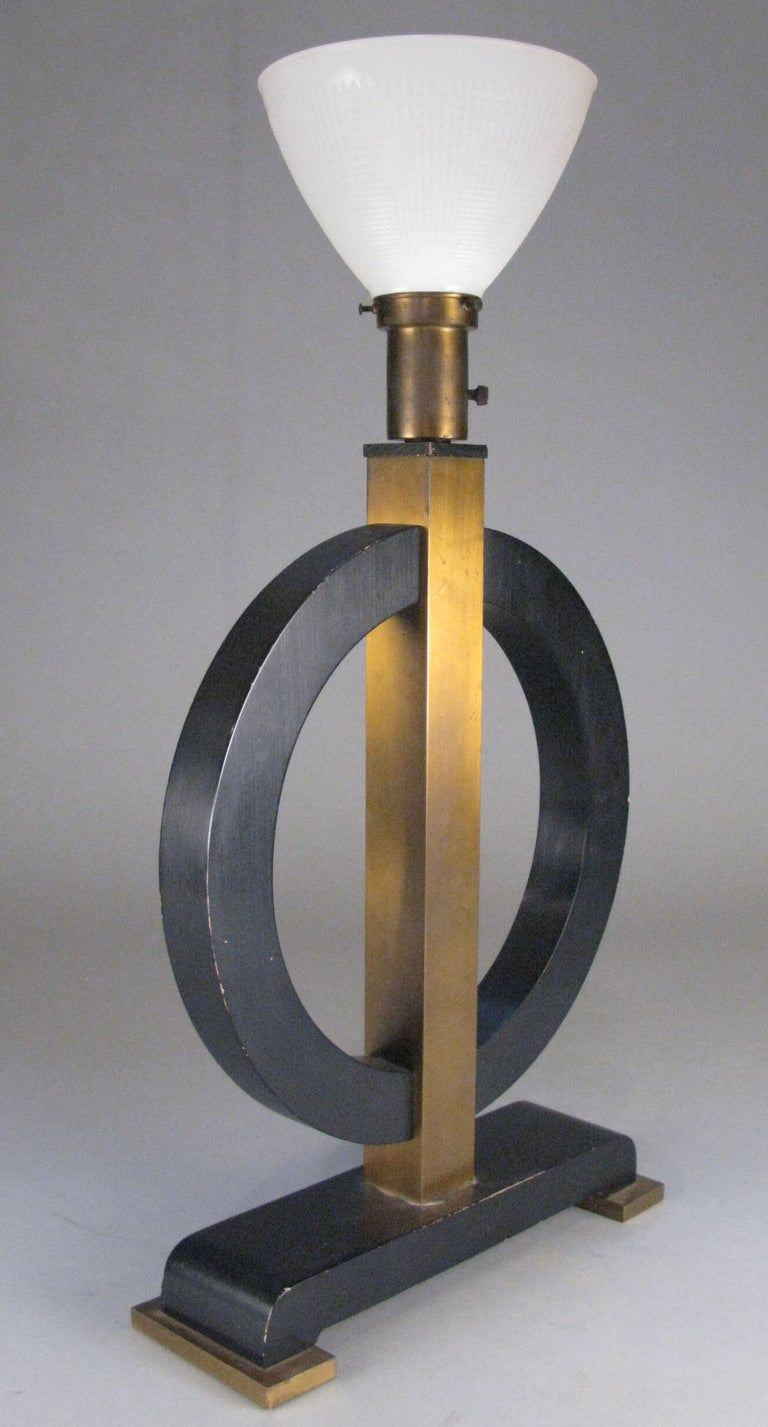 Art deco brass and lacquered circle lamp at 1stdibs for Art deco era dates