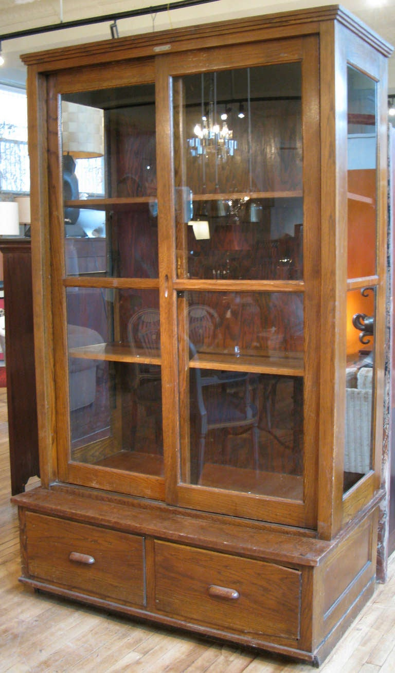 Antique oak and glass display cabinet at 1stdibs for Antique display cabinet