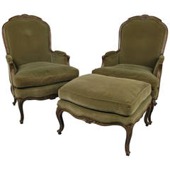 Pair of French Style Velvet Lounge Chairs and Ottoman