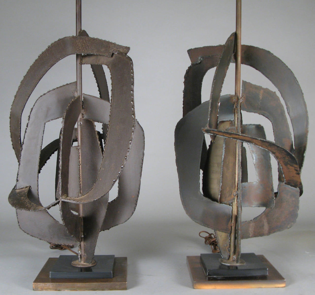 A wonderful pair of vintage 1960s table lamps designed by Harry Balmer for Laurel Lamp Co., made from torch cut steel and iron in an open abstract form, on a steel and copper base. Shades not included.