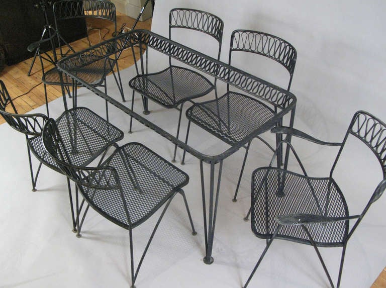 this 1950 39 s wrought iron dining set with six chairs by salterini is no