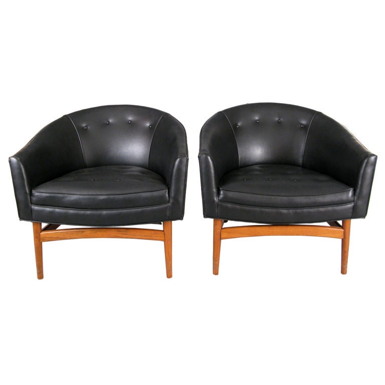 This pair of modern curved back lounge chairs is no longer available