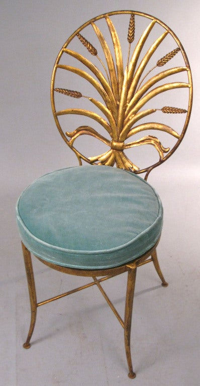 a beautiful pair of vintage 1960's Italian chairs with elaborately detailed backs in the design of a sheaf of wheat. raised on gorgous slim legs with X stretchers, they are finished in classic Italian gilt gold. made by S. Salvadori - Firenze c.