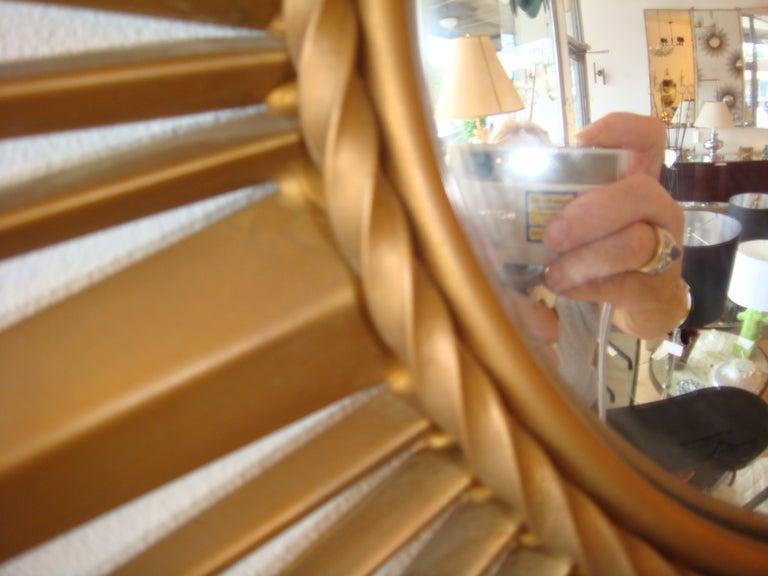 Brass sunburst mirror (