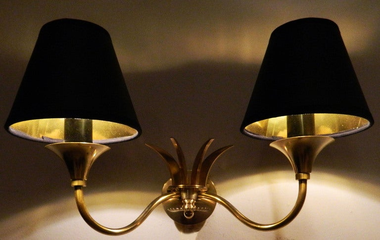Pair of French brass sconces by Maison Jansen. US wired and in working condition Have a look on our impressive collection of French and Italian Mid-Century period sconces, more than 100 pairs..