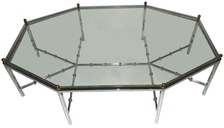 Faux Bamboo chrome base for this rare and elegant Maison Jansen octagonal coffee table .The eight side of 18.5
