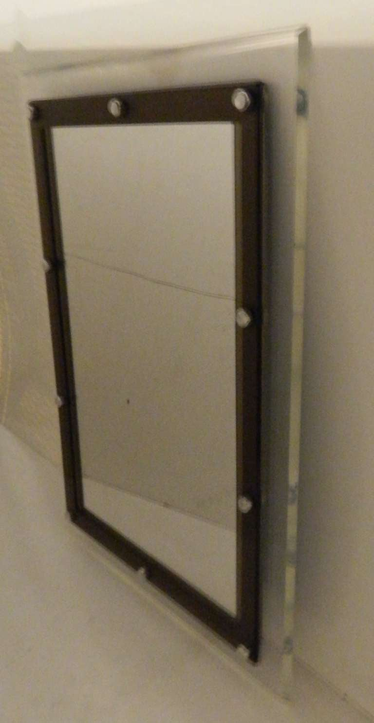 Double Lucite frame rectangular mirror, clear Lucite for the back and dark smoked Lucite for the front, polished aluminum bolt. Measurement of the mirror : 21