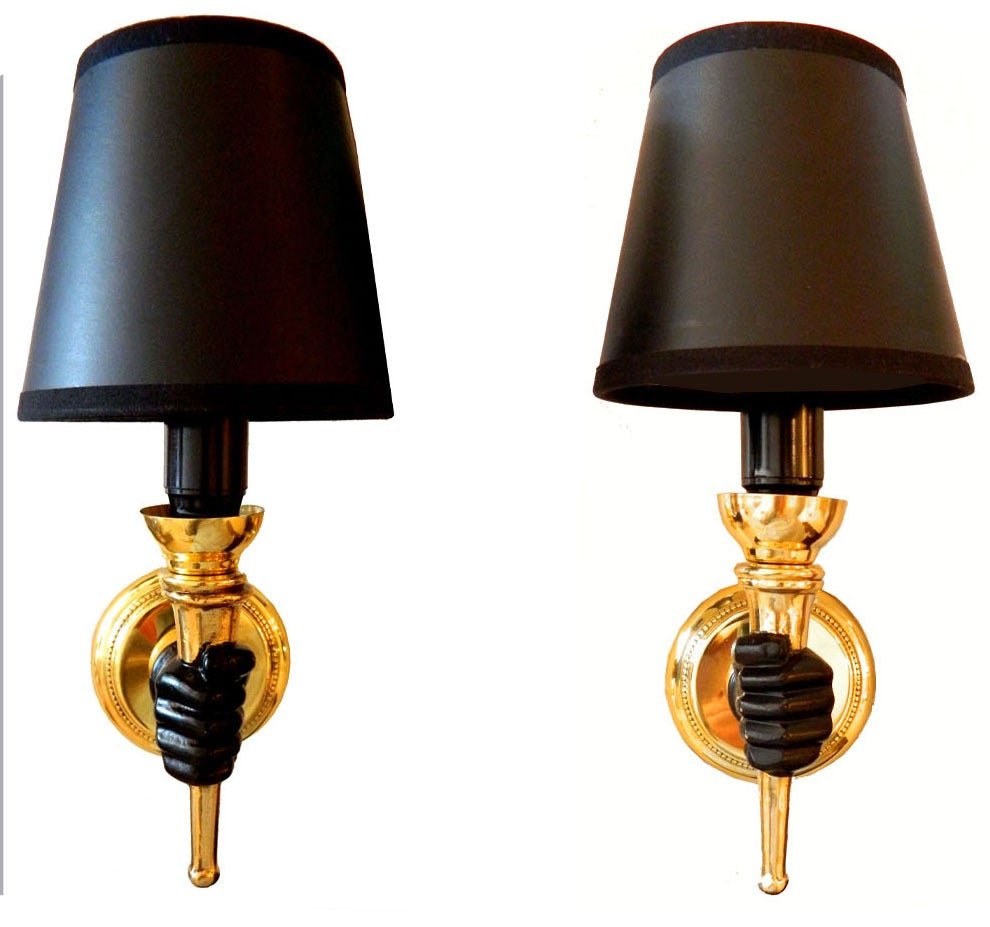3 Pairs available of ARBUS wall sconces featuring a hand holding a torch. Measurement without shades: 6.5