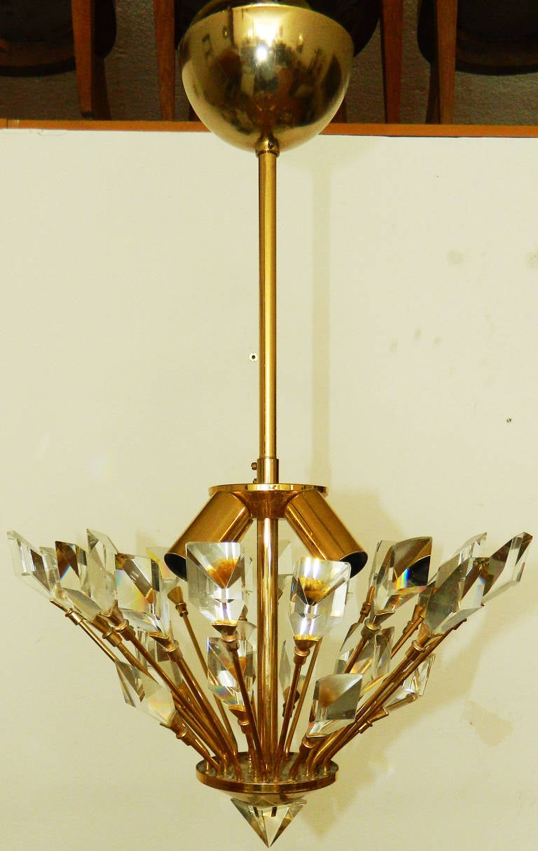 Crystal and brass 1970s Italian chandelier. US wired and in working condition.