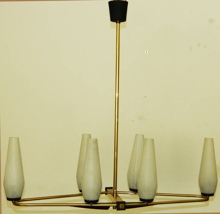 Stilnovo six lights chandelier, original glass shades. 60w/ bulb.  2 patinas brass. Polished brass / gun metal US wired and in working condition.