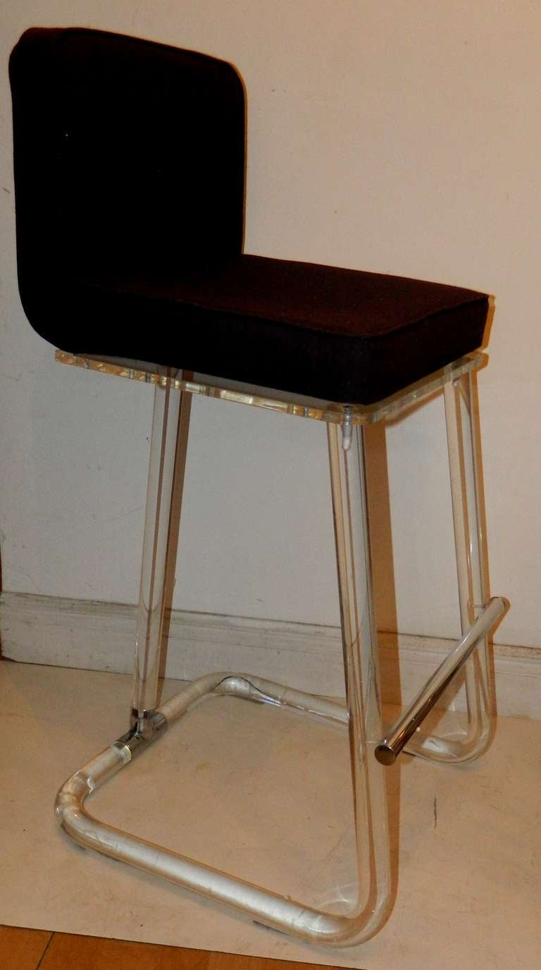 Lucite and brass pair of Lion in Frost St. Bar stools.  Swiveling seat.  Black ultra suede top seat. 10