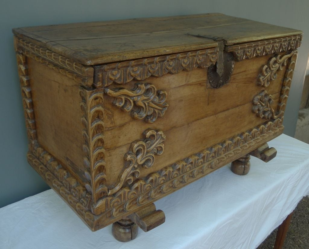 18th century sabino wood trunk with applied sabino wooden decorations.