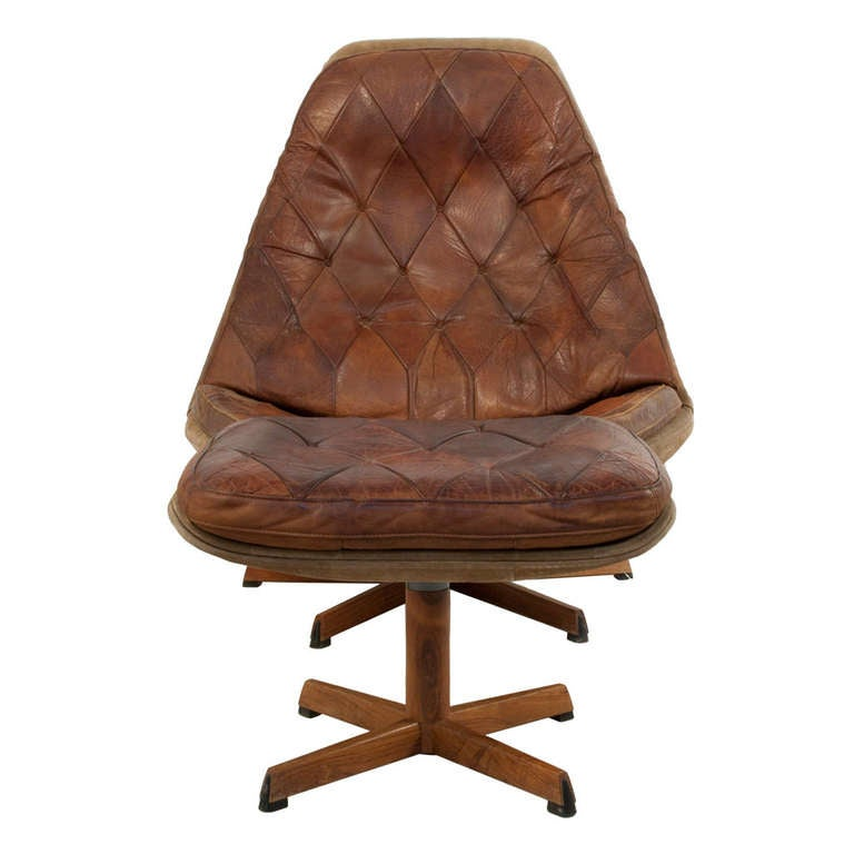Leather And Suede Swivel Chair With Foot Stool At 1stdibs