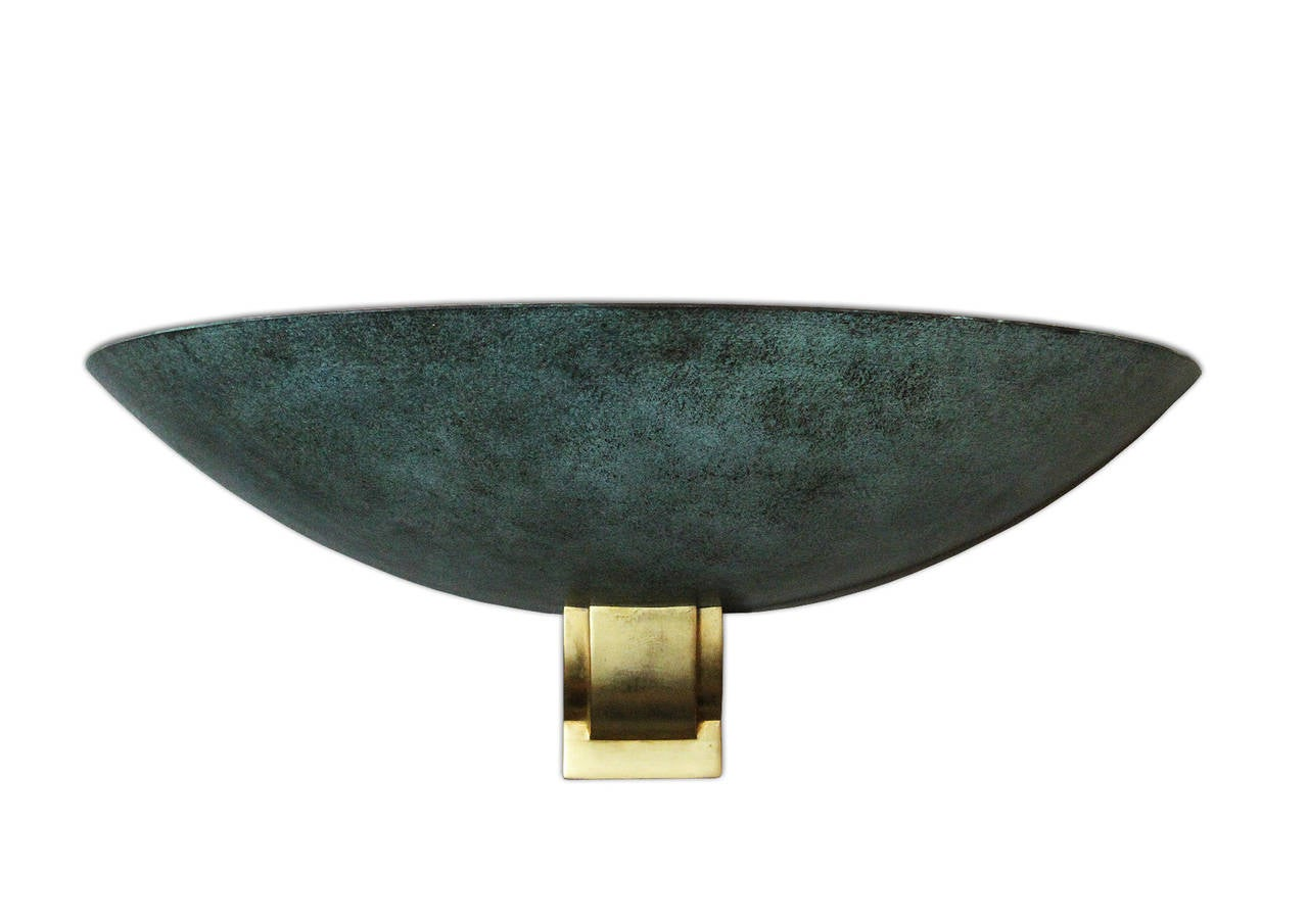Very rare and important large sconce attributed to Perzel. We have a set of seven but we split six + one. This price is for one, the set of six is also listed on 1stdibs. The metal shade is lacquered in green or black cloudy tones outside and