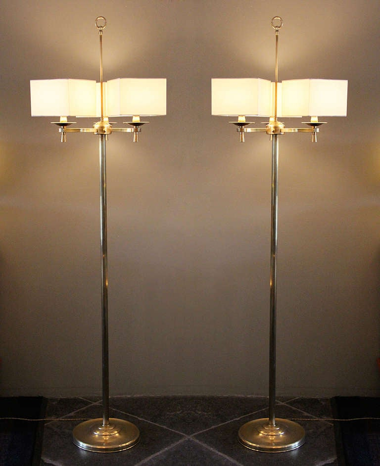Stunning pair of Art Deco bronze floor lamps from the prestigious Prince de Galles hotel in Paris, France, circa 1940.