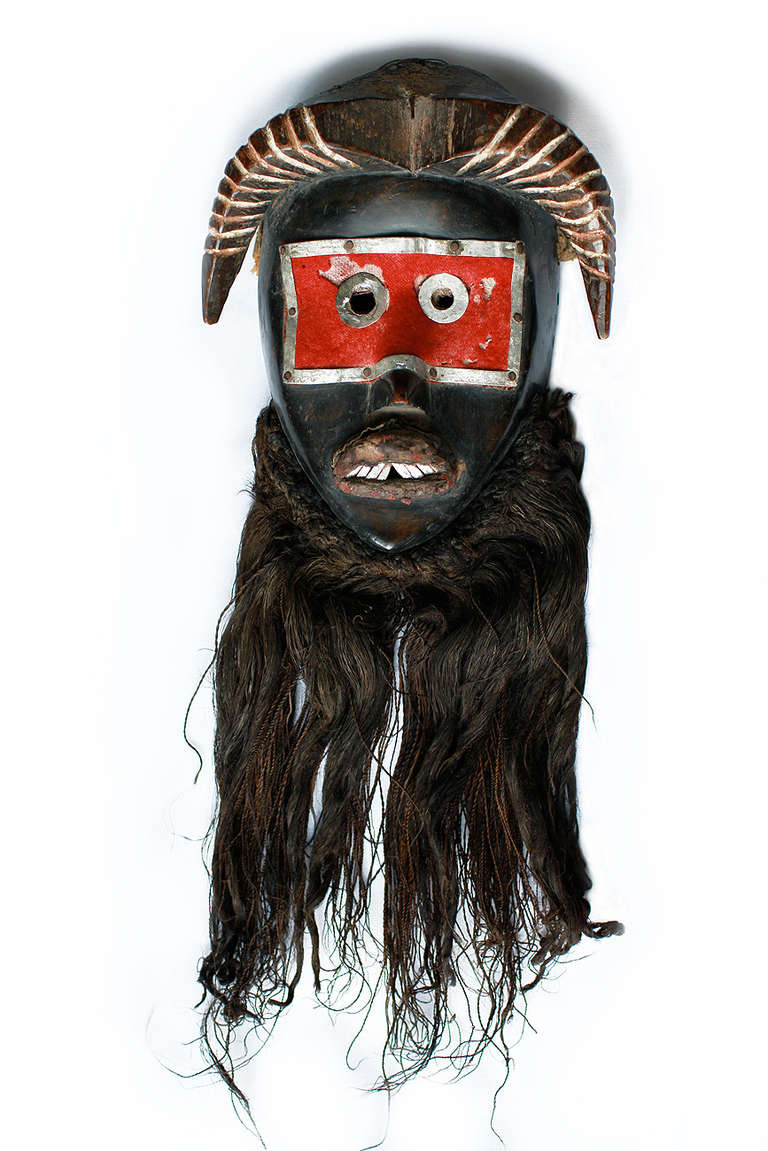 Extremely rare and old Dan Toura Mask. Cote d'Ivoire, Ivory Coast, circa 1920-1930. In Africa, villages were under authority of a chief and a council of elders, and this kind of mask called Nyoma Wum was only worn by the chief or the authority