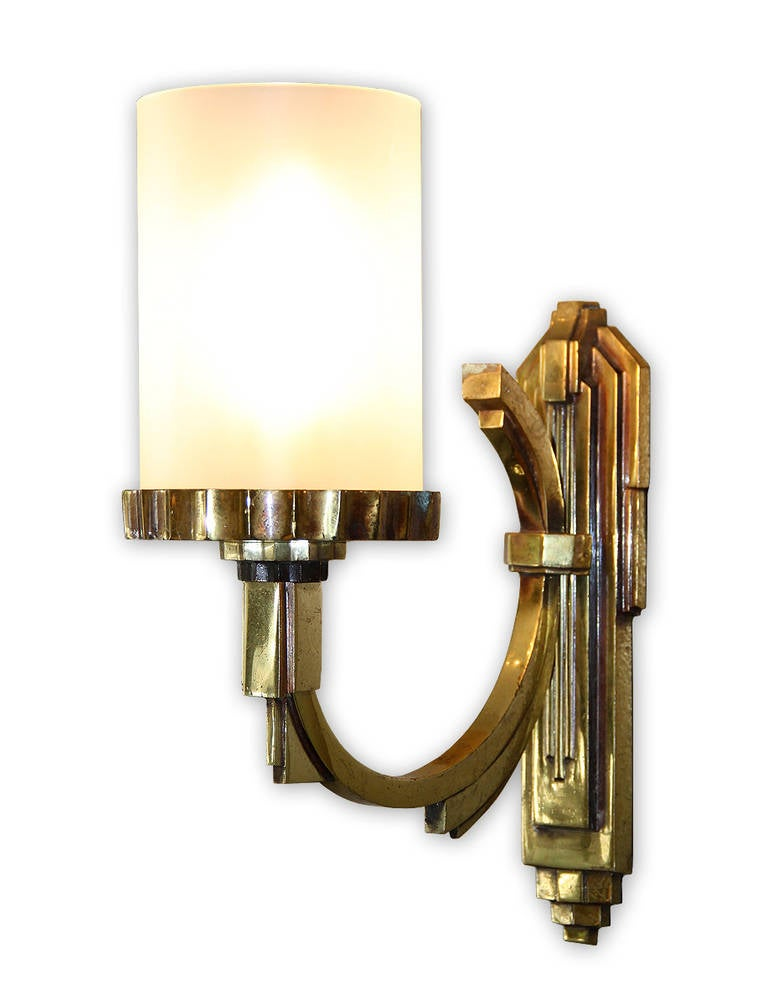 Maison Petitot, one single gilt bronze sconce with a tubular frosted glass lampshade, France, circa 1930. This sconce comes from a set of four, three has been sold and one is available now. Measurements: Height: 12