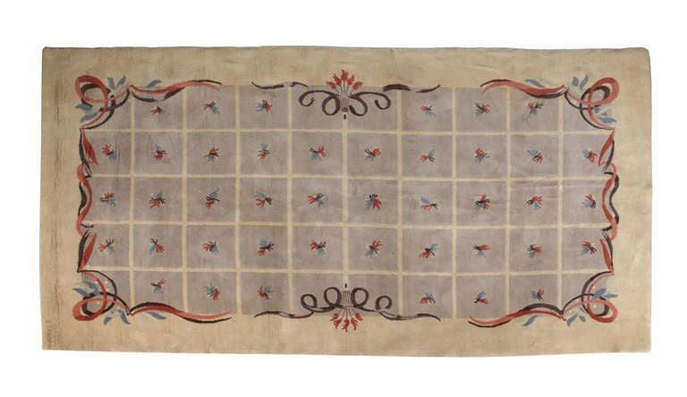 Beautiful rare handwoven rug designed by Batistin Spade. Features an elegant floral motif pattern in soft pastel colors over a warm beige background.
