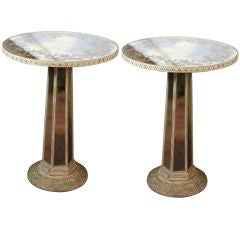 Pair of mirrored reverse painted pedestal tables