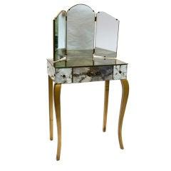 Smoky mirrored vanity with gold flecks