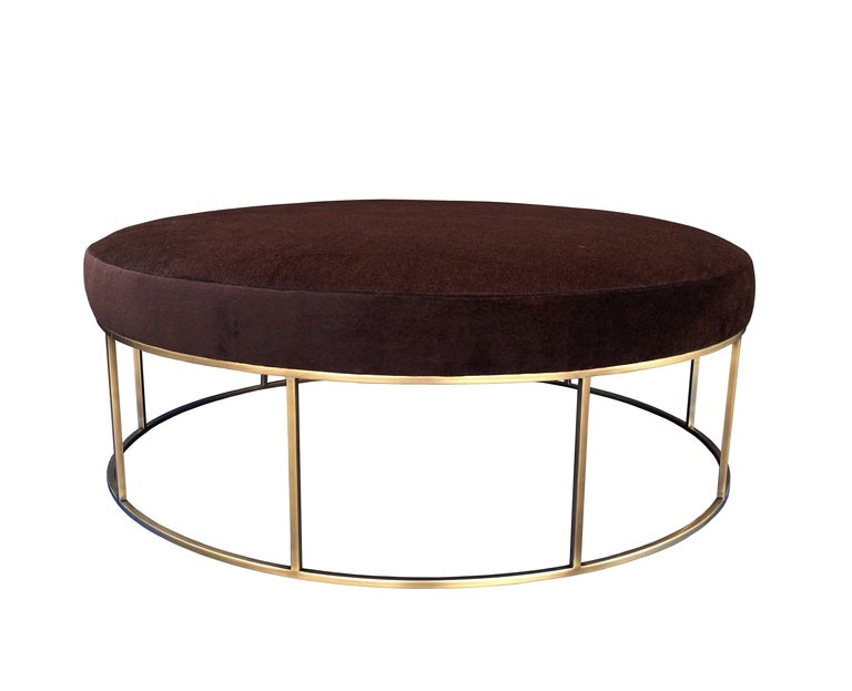 Beautiful round loveseat with upholstered top. This beautiful loveseat can be used indoors or outdoors, it is perfect for homes with large living or family rooms, ideal for entertaining. The base is beautifully crafted in solid brass finished in