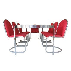 1970's Expandable Chrome and Glass Dining Table and 8 Chairs