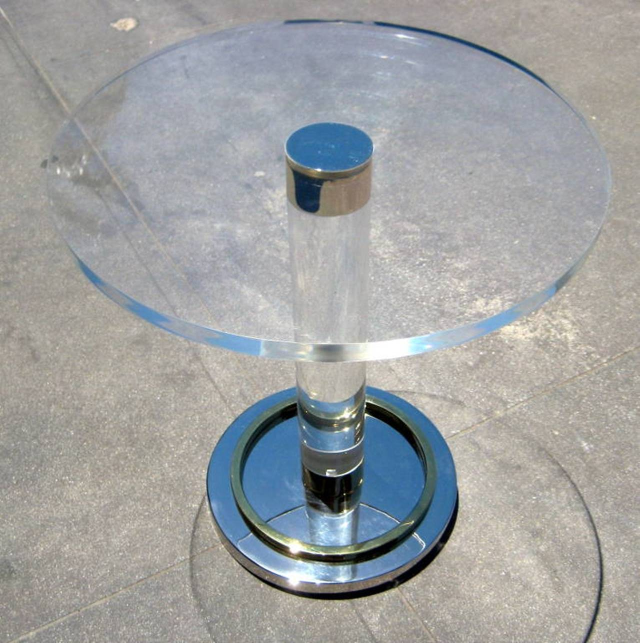 Stunning side table in Lucite, brass and polished nickel. The table is a vintage piece designed in the 1960s and in excellent condition, the top is new and in mint condition.  The table is signed and dated by the artist. Measurements: 19