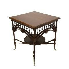 1800s English Carved Mahogany Table with Brass Legs