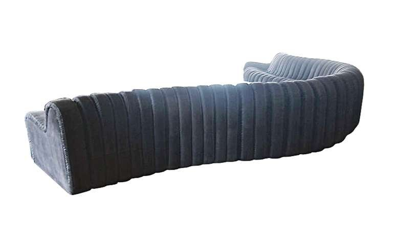 Stunning nonstop style modular sofa consisting of a seven-piece sectional attached together in an accordion manner to form a crescent moon shape sofa.