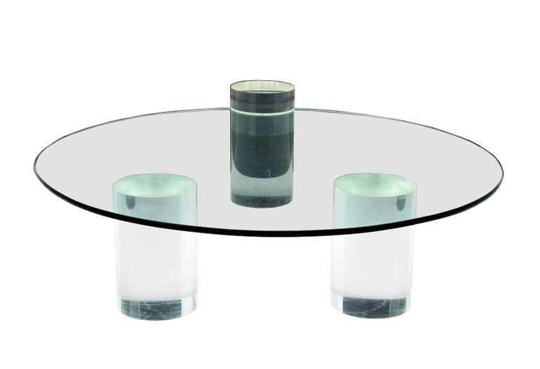 Exceptional coffee table designed by Charles Hollis Jones in the 1970s, the coffee table is very large in size and versatile, the thick Lucite legs can be arranged in different positions and the taller one is meant to be used as a