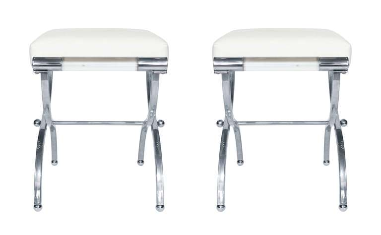 Exceptional pair of Empire style benches designed and manufactured by Charles Hollis Jones. The benches were designed in the 1960s and they are just as influential today.  Measurements: 20