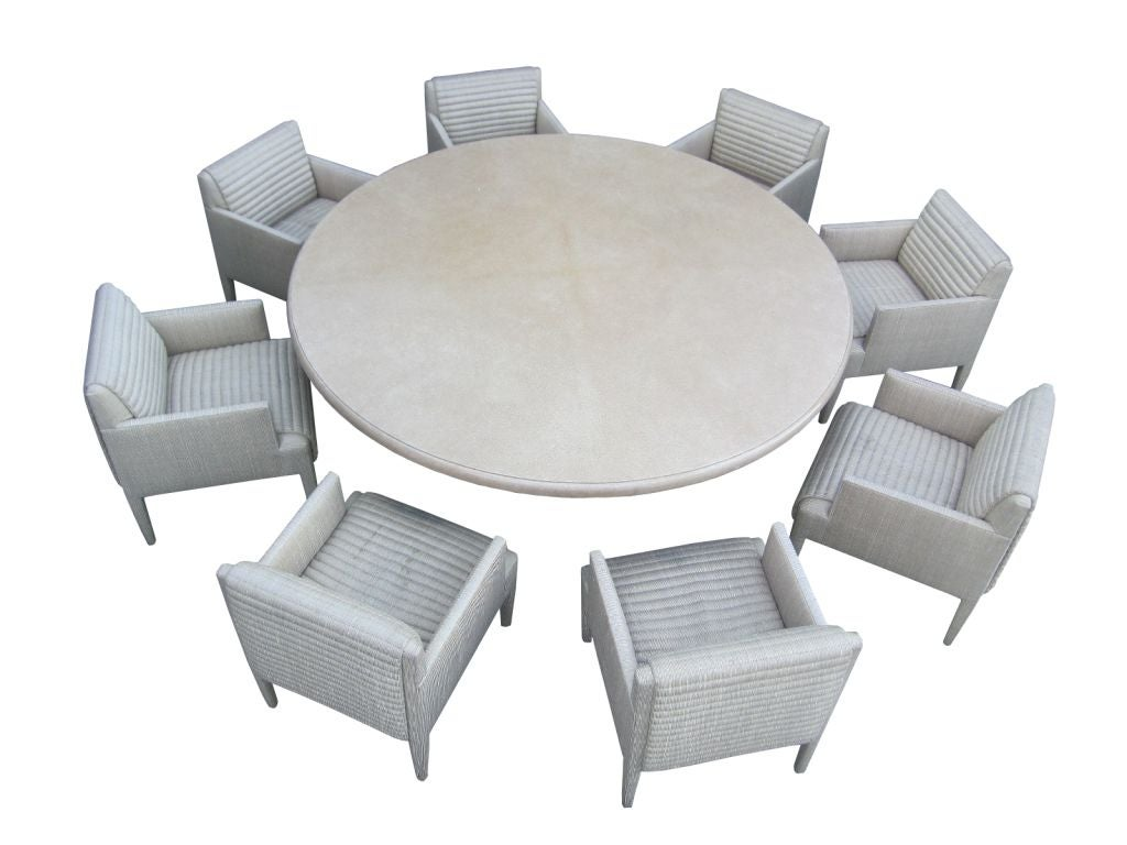 custom round conference table and 8 arm chairs by donghia