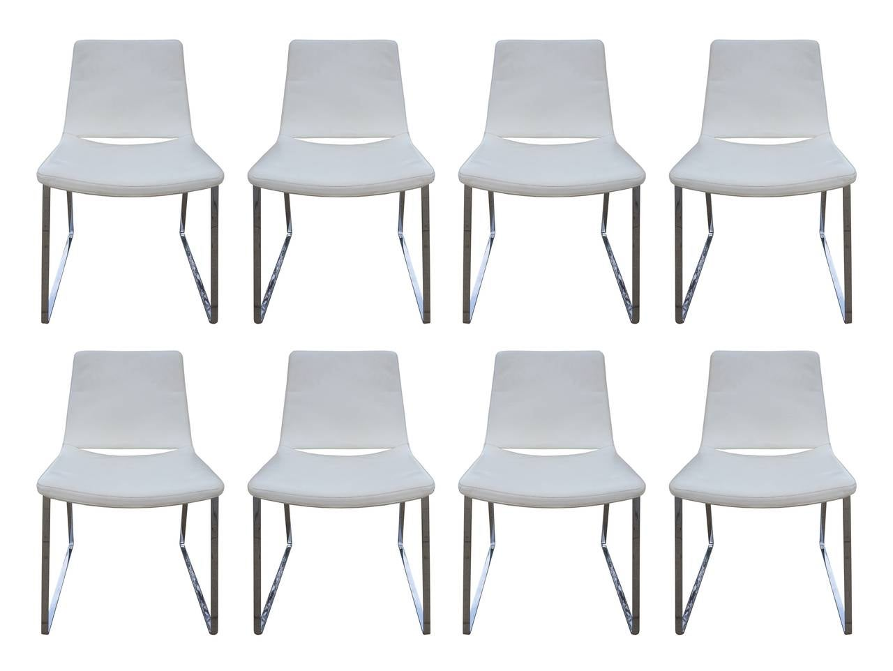 Beautiful set of eight dining chairs in white leather designed by Jeffrey Bernett and part of his ME-48 Metropolitan line.