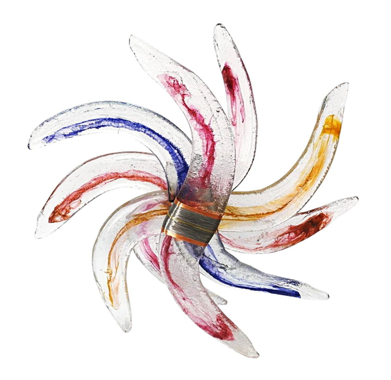 Monumental glass floor sculpture in a pinwheel form with copper and steel wrapped center details.  The glass has a wonderful textured and there are bright blue, red, yellow and orange colors infused on the glass. The sculpture can seat on the