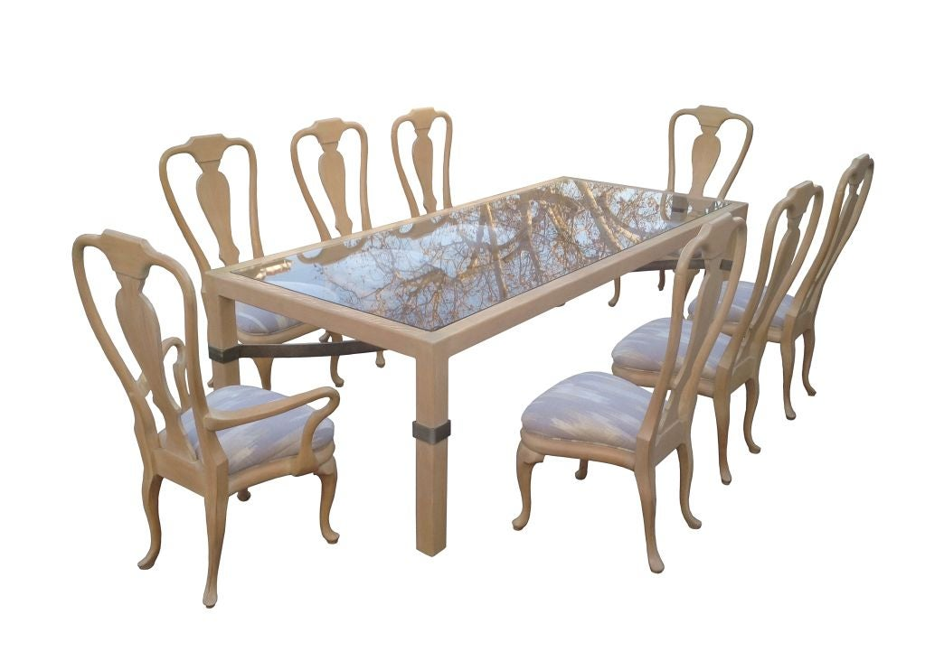 Beautiful and stylish dining set by the designer to the stars, Phyllis Morris. This fantastic set features one large custom dining table with a very beautiful metal stretcher and eight Queen Anne chairs, two arm and six side chairs. The set is in