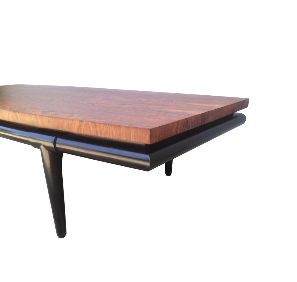 Stunning rosewood coffee table designed by Maurice Bailey for Monteverdi-Young of Beverly Hills, California back in the 1960s.  The frame of the table is made of solid mahogany wood finish in black lacquer, both the frame and top are in excellent