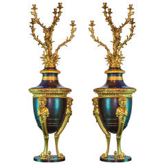 Pair of French Louis XVI Style Patinated and Gilt Bronze Figural Torcheres