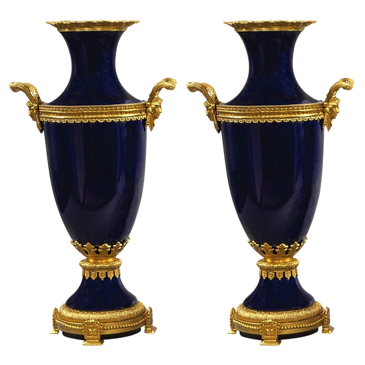 Three piece cobalt blue porcelain and bronze vase