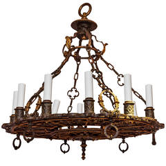 Patinated and Gilt Bronze Wheel Form 12-Light Chandelier