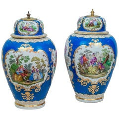 Pair of Meissen Style Blue Porcelain Covered Jars with Painted Scenes