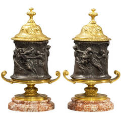 Signed Pair of Patinated and Gilt Bronze Figural Covered Urns